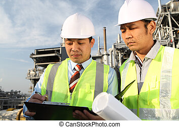 two engineer discussing a new project - two engineer oil...
