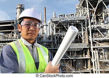engineer oil refinery - engineer standing in front of a...