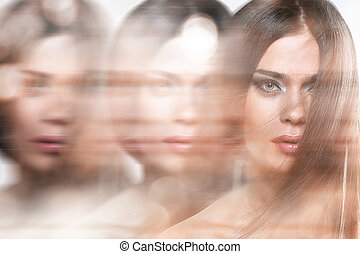 Attractive woman with long hair in motion effect