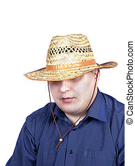 young man in a blue shirt with a straw hat in hand