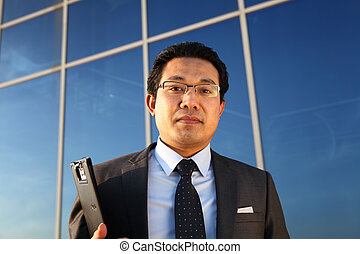 young businessman holding documen