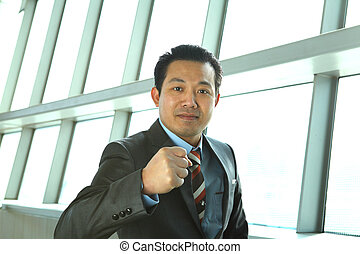potrait succes businessman standing front window office