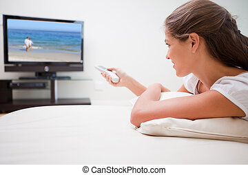 Woman watching television - Young woman watching television