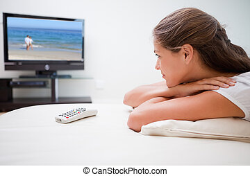 Woman watching a movie - Young woman watching a movie