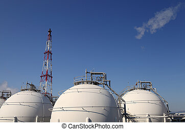 petrochemical plant - petrochemicals with smoke and blue sky...