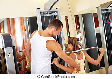 Workout on facilities - Portrait of sporty female doing...