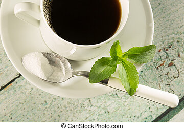 Coffee with stevia - Highkey image of a cup of coffee with...
