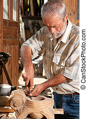 Woodwork carpenter - Senior carpenter working with wood in...