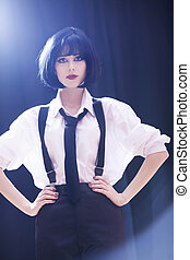 Fashion women with tie. Studio shot with backlight.