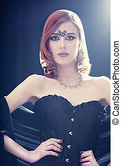 Fashion women in corset Photo with backlight