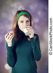 American redhead girl with milk and cake. Photo in 60s style.