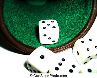 tumbler and dice over a white background