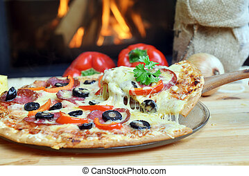 tasty pizza - Pizza lifting slice with pepperoni and olives