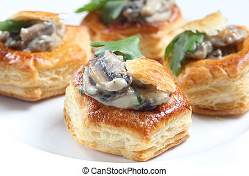Homemade mushroom vol-au-vents garnished with a parsley leaf