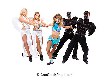 Actors dressed as angels and demons posing on an isolated...