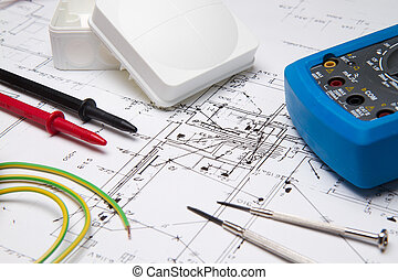 Electrical instruments laying on blueprint - A set of...