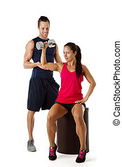 Personal trainer dumbbell lifting - Personal trainer assists...