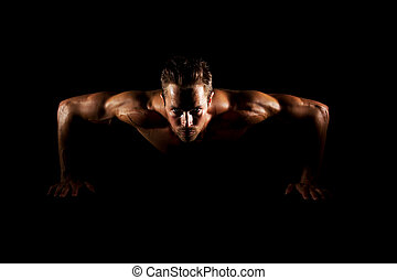 Man doing pushups - Man with focused eyes doing pushups on...