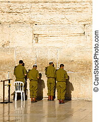The soldiers of the Israeli army are praying at the Western...