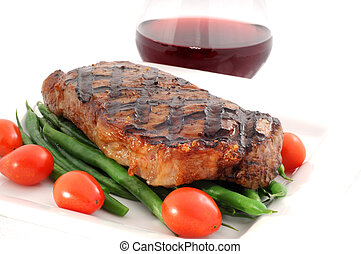 Ribeye Steak - Ribeye steak grilled to perfection with green...