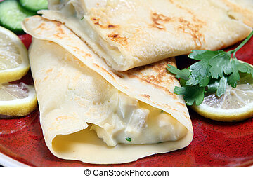 Crepe with chicken filling - Crepe filled with chicken in...