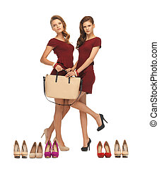 two teenage girls in red dresses with bag - picture of two...