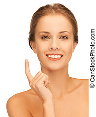 beautiful woman with moisturizing creme drop - picture of...