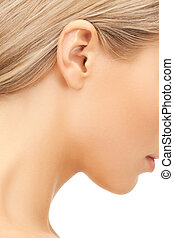 picture of woman's ear - bright closeup picture of woman's...
