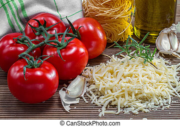 Grated cheese and tomatoes on a board