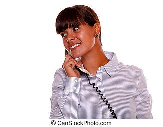 Smiling young woman looking right with phone