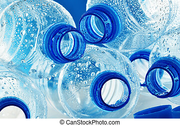 Composition with empty polycarbonate plastic bottles of...