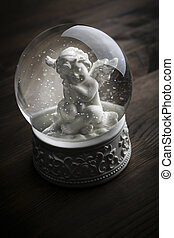 snow globe with snow flakes and angel - snow globe with snow...