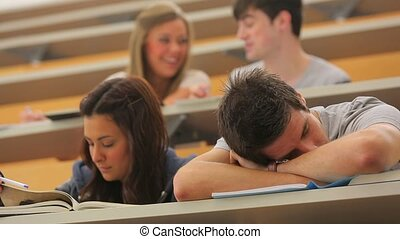 Student sleeping at the lecture hal