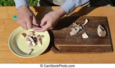 hand knife cut mushroom - Man hands clean and cut slice red...