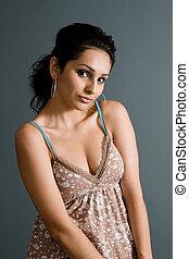 vulnerable latina in brown top showing nice collarbones