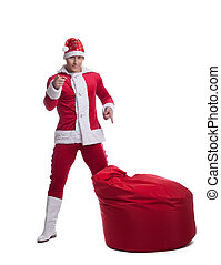 Young Santa Claus with bag - Full length portrait of young...