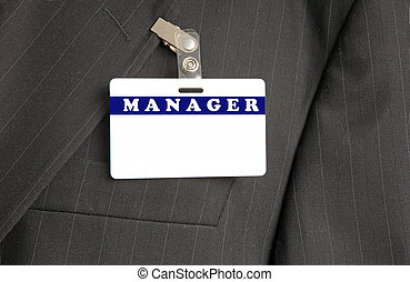 Badge Manager - Close Up of Black Suit with Manager ID Card...