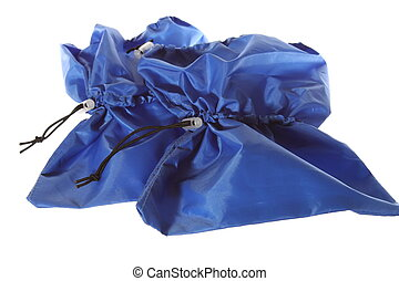 isolated blue shoe covers on the white background - The...