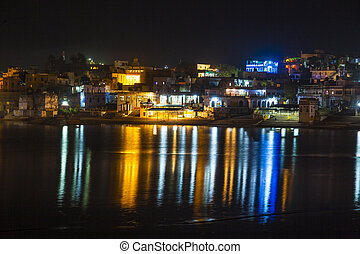 reflection of the ghats in Pushkar in the lake by night
