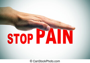 stop pain - a man hand above the sentence stop pain written...