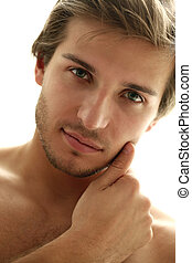 Charming and handsome man face close up over a white...