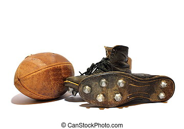 Football and Cleats - Antique football and cleats sitting on...