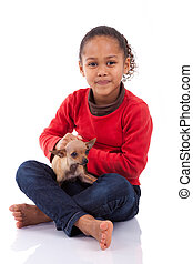 African American little girl with her pet, isolated on white...
