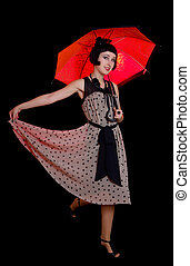 woman in retro styled dress with red umbrella