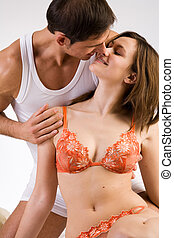 The loving kiss - Young adult couple in the studio kissing