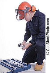 workman with socket set - workman in safety clothing with...