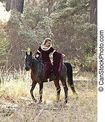 medieval woman riding horse in forest - medieval woman in...