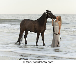 medieval woman and horse in water, time exposure with...