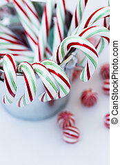Candy canes - Peppermint candy canes on white background.