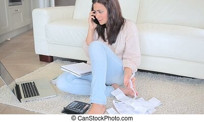 Woman doing accounting - Upset woman doing accounting while...